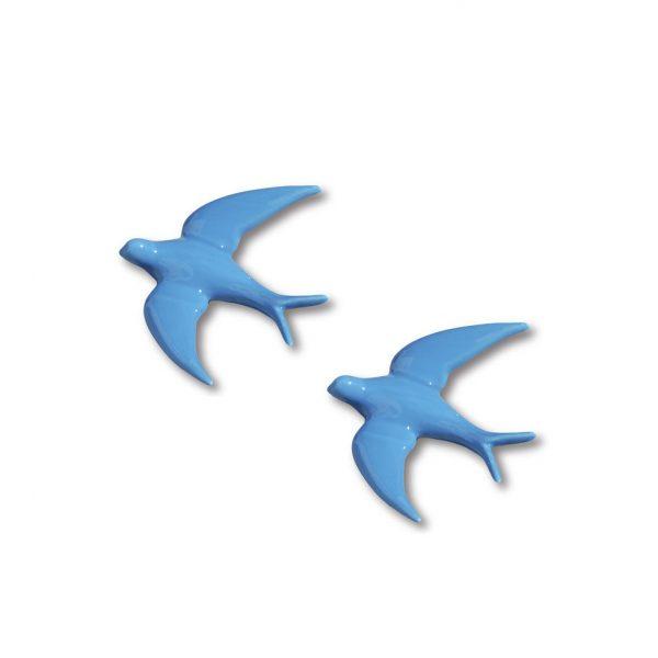 Golondrina de color azul de cerámica esmaltada